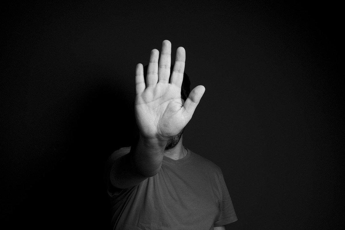 Man holding up his hand in a stop gesture